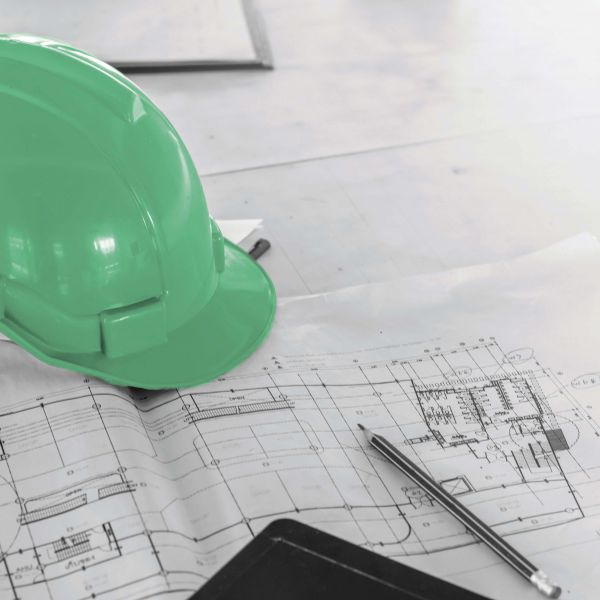 The blue safety helmet and the blueprint at construction site